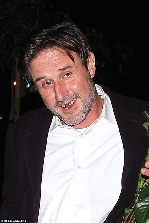 David Arquette shows off new gold teeth etched with his