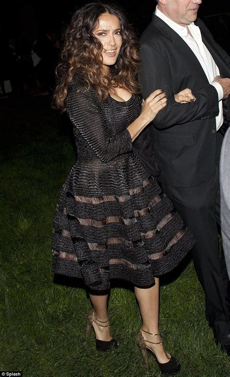 We see through you! Salma Hayek bares all in a transparent